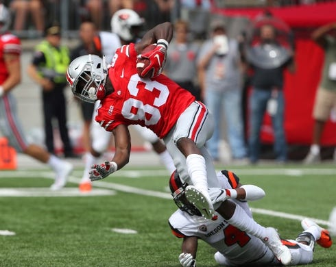 Sep 1, 2018; Columbus, OH, USA; Ohio State Buckeyes wide receiver Terry McLaurin (83) is tackled by Oregon State Beavers cornerback Dwayne Williams (4) during the first quarter at Ohio Stadium. Mandatory Credit: Joe Maiorana-USA TODAY Sports