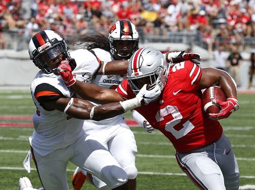 Sep 1, 2018; Columbus, OH, USA; Ohio State Buckeyes running back J.K. Dobbins (2) gets face masked by Oregon State Beavers safety Jeffrey Manning Jr. (15)during the first quarter at Ohio Stadium. Mandatory Credit: Joe Maiorana-USA TODAY Sports
