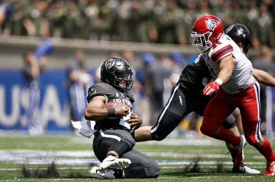 Sep 1, 2018; Colorado Springs, CO, USA; Air Force Falcons quarterback Arion Worthman (2) slides for a first down ahead of Stony Brook Seawolves linebacker Noah McGinty (41) in the second quarter at Falcon Stadium. Mandatory Credit: Isaiah J. Downing-USA TODAY Sports