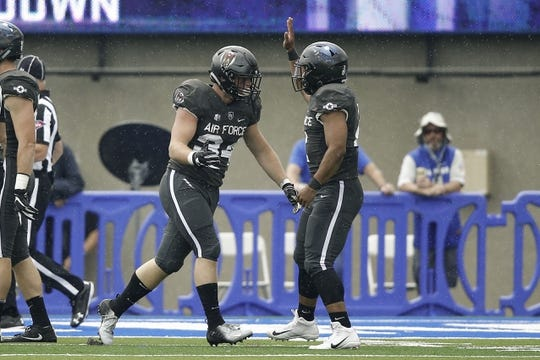 Sep 1, 2018; Colorado Springs, CO, USA; Air Force Falcons fullback Cole Fagan (34) celebrates his touchdown with quarterback Arion Worthman (2) in the second quarter against the Stony Brook Seawolves at Falcon Stadium. Mandatory Credit: Isaiah J. Downing-USA TODAY Sports