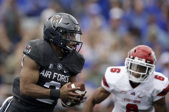 Sep 1, 2018; Colorado Springs, CO, USA; Air Force Falcons quarterback Arion Worthman (2) runs the ball under pressure from Stony Brook Seawolves cornerback TJ Morrison (6) in the first quarter at Falcon Stadium. Mandatory Credit: Isaiah J. Downing-USA TODAY Sports