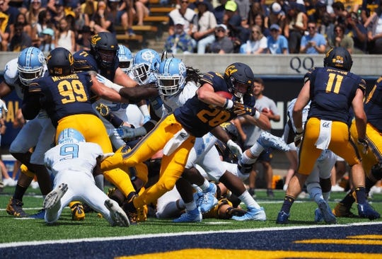 Sep 1, 2018; Berkeley, CA, USA; California Golden Bears running back Patrick Laird (28) scores a touchdown against the North Carolina Tar Heels during the first quarter at California Memorial Stadium. Mandatory Credit: Kelley L Cox-USA TODAY Sports