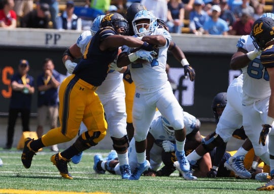 Sep 1, 2018; Berkeley, CA, USA; North Carolina Tar Heels running back Antonio Williams (24) carries the ball against California Golden Bears defensive end Zeandae Johnson (44) during the first quarter at California Memorial Stadium. Mandatory Credit: Kelley L Cox-USA TODAY Sports