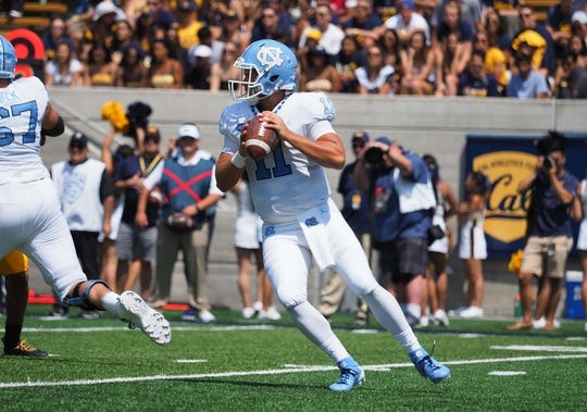 Sep 1, 2018; Berkeley, CA, USA; North Carolina Tar Heels quarterback Nathan Elliott (11) in motion before throwing the ball against the California Golden Bears during the first quarter at California Memorial Stadium. Mandatory Credit: Kelley L Cox-USA TODAY Sports