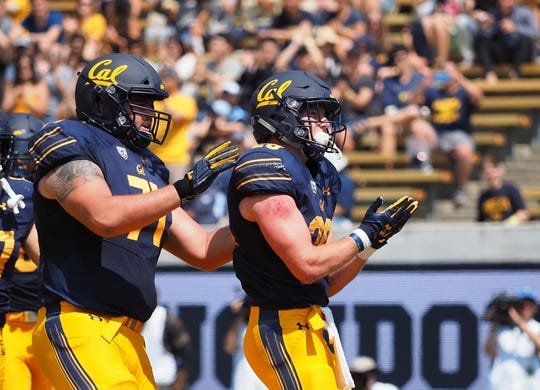 Sep 1, 2018; Berkeley, CA, USA; California Golden Bears running back Patrick Laird (28) gestures reading a book after scoring a touchdown against the North Carolina Tar Heels during the first quarter at California Memorial Stadium. Mandatory Credit: Kelley L Cox-USA TODAY Sports