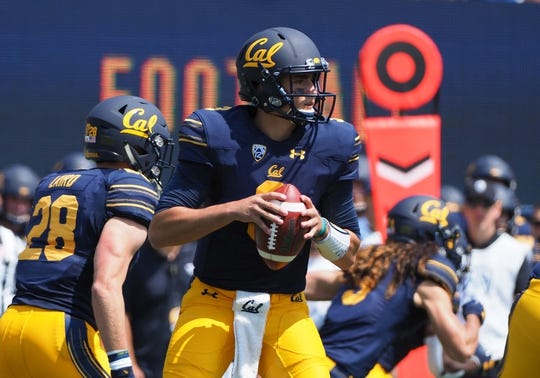 Sep 1, 2018; Berkeley, CA, USA; California Golden Bears quarterback Ross Bowers (3) controls the ball against the North Carolina Tar Heels during the first quarter at California Memorial Stadium. Mandatory Credit: Kelley L Cox-USA TODAY Sports