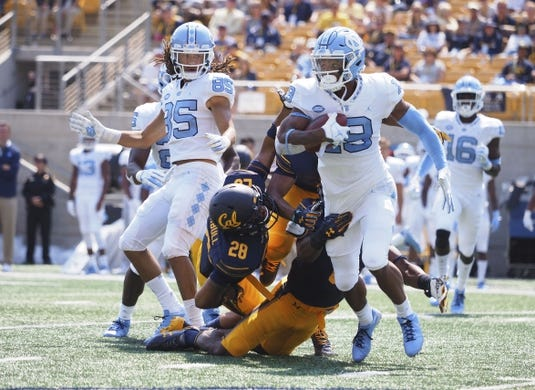Sep 1, 2018; Berkeley, CA, USA; North Carolina Tar Heels wide receiver Dazz Newsome (19) carries the ball against the California Golden Bears during the second quarter at California Memorial Stadium. Mandatory Credit: Kelley L Cox-USA TODAY Sports