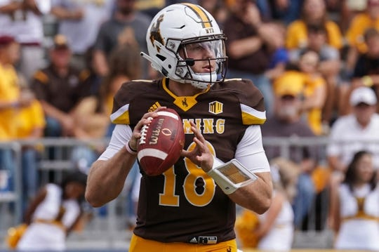 Sep 1, 2018; Laramie, WY, USA; Wyoming Cowboys quarterback Tyler Vander Waal (18) prepares to throw against the Washington State Cougars during the first quarter at Jonah Field War Memorial Stadium. Mandatory Credit: Troy Babbitt-USA TODAY Sports