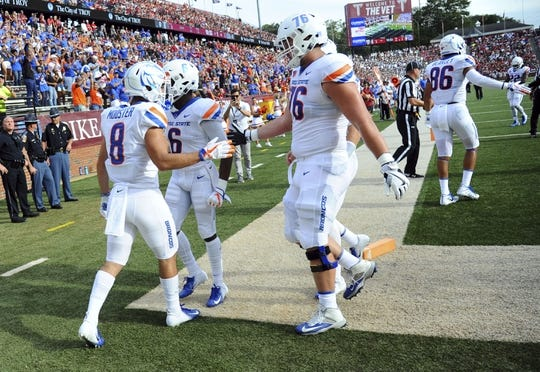 Sep 1, 2018; Troy, AL, USA; Boise State Broncos wide receiver Sean Modster (8) is congratulated by teammates after a touchdown during the first half against the Troy Trojans at Veterans Memorial Stadium. Mandatory Credit: Christopher Hanewinckel-USA TODAY Sports
