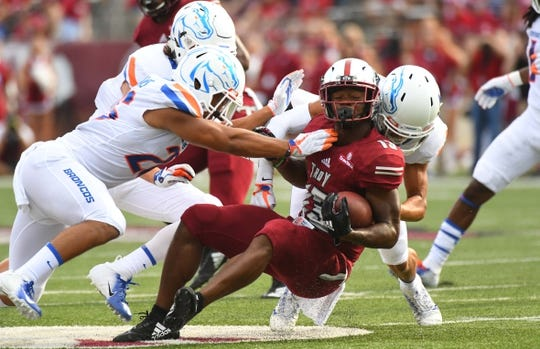 Sep 1, 2018; Troy, AL, USA; Troy Trojans wide receiver Tray Eafford (13) is tackled after a short gain on a catch against the Boise State Broncos during the first half at Veterans Memorial Stadium. Mandatory Credit: Christopher Hanewinckel-USA TODAY Sports