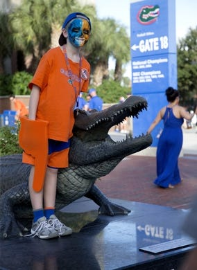 Sep 1, 2018; Gainesville, FL, USA; Nathan Owens, a 12 year old Florida Gator fan, poses for a photo before the Florida Gators host the Charleston Southern Buccaneers at Ben Hill Griffin Stadium. Mandatory Credit: Glenn Beil-USA TODAY Sports