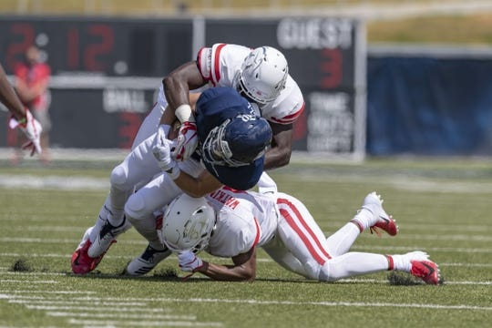Sep 1, 2018; Houston, TX, USA; Rice Owls wide receiver Austin Trammell (10) gets tackled by Houston Cougars cornerback Nick Watkins (9) with help from defensive tackle Ed Oliver (10) at Rice Stadium. Mandatory Credit: Maria Lysaker-USA TODAY Sports