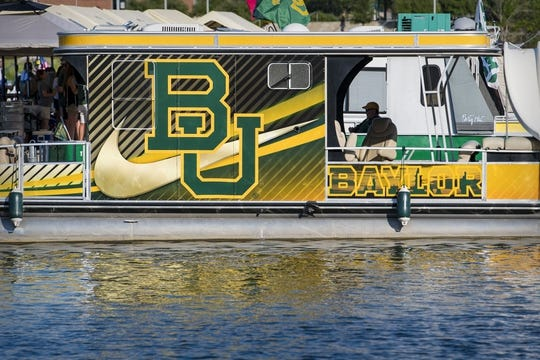 Sep 1, 2018; Waco, TX, USA; A view of a houseboat with the Baylor Bears logo on party cove before the game between the Bears and the Abilene Christian Wildcats at McLane Stadium. Mandatory Credit: Jerome Miron-USA TODAY Sports
