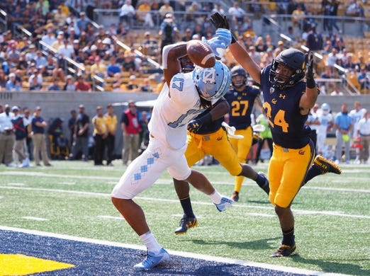 Sep 1, 2018; Berkeley, CA, USA; California Golden Bears cornerback Camryn Bynum (24) prevents a pass intended for North Carolina Tar Heels wide receiver Anthony Ratliff-Williams (17) during the third quarter at California Memorial Stadium. Mandatory Credit: Kelley L Cox-USA TODAY Sports