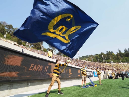 Sep 1, 2018; Berkeley, CA, USA; California Golden Bears student waves a flag during the third quarter against the North Carolina Tar Heels at California Memorial Stadium. Mandatory Credit: Kelley L Cox-USA TODAY Sports