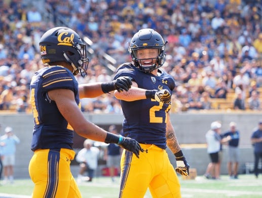 Sep 1, 2018; Berkeley, CA, USA; California Golden Bears cornerback Camryn Bynum (24) celebrates with safety Ashtyn Davis (27) after breaking up a pass against the North Carolina Tar Heels during the third quarter at California Memorial Stadium. Mandatory Credit: Kelley L Cox-USA TODAY Sports