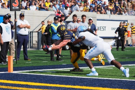 Sep 1, 2018; Berkeley, CA, USA; California Golden Bears running back Patrick Laird (28) scores a touchdown against the North Carolina Tar Heels during the third quarter at California Memorial Stadium. Mandatory Credit: Kelley L Cox-USA TODAY Sports