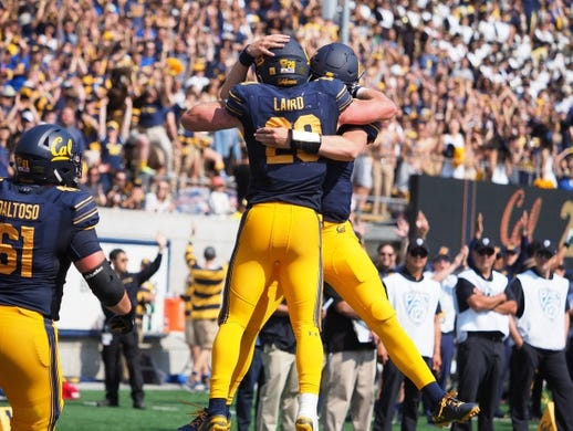 Sep 1, 2018; Berkeley, CA, USA; California Golden Bears running back Patrick Laird (28) celebrates after a scoring touchdown against the North Carolina Tar Heels during the third quarter at California Memorial Stadium. Mandatory Credit: Kelley L Cox-USA TODAY Sports