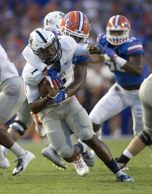 Sep 1, 2018; Gainesville, FL, USA; Charleston Southern Buccaneers quarterback London Johnson (1) is sacked by Florida Gators defensive back Chauncey Gardner-Johnson (23) during the first quarter at Ben Hill Griffin Stadium. Mandatory Credit: Glenn Beil-USA TODAY Sports