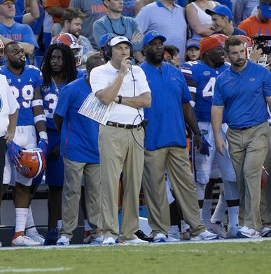 Sep 1, 2018; Gainesville, FL, USA; Florida Gators head coach Dan Mullen watches during the first quarter of play against the Charleston Southern Buccaneers at Ben Hill Griffin Stadium. Mandatory Credit: Glenn Beil-USA TODAY Sports