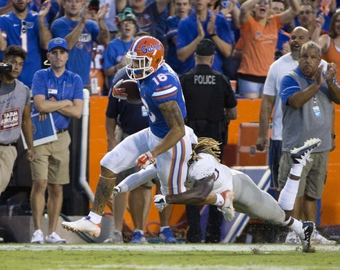 Sep 1, 2018; Gainesville, FL, USA; Florida Gators wide receiver Freddie Swain (16) picks up a first down during the first quarter against Charleston Southern at Ben Hill Griffin Stadium. Mandatory Credit: Glenn Beil-USA TODAY Sports