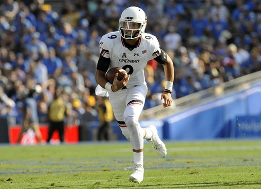 September 1, 2018; Pasadena, CA, USA; Cincinnati Bearcats quarterback Desmond Ridder (9) runs the ball against the UCLA Bruins during the first half at the Rose Bowl. Mandatory Credit: Gary A. Vasquez-USA TODAY Sports