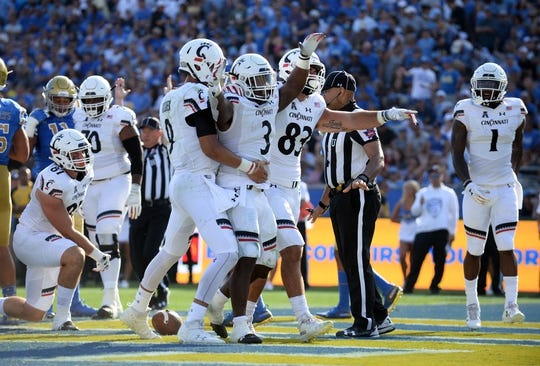 September 1, 2018; Pasadena, CA, USA; Cincinnati Bearcats running back Michael Warren II (3) celebrates his touchdown scored against the UCLA Bruins during the first half at the Rose Bowl. Mandatory Credit: Gary A. Vasquez-USA TODAY Sports