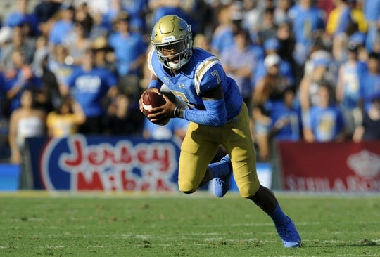 September 1, 2018; Pasadena, CA, USA; UCLA Bruins quarterback Dorian Thompson-Robinson (7) runs the ball against the Cincinnati Bearcats during the first half at the Rose Bowl. Mandatory Credit: Gary A. Vasquez-USA TODAY Sports
