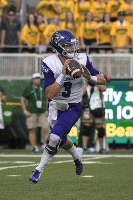 Sep 1, 2018; Waco, TX, USA; Abilene Christian Wildcats quarterback Luke Anthony (3) rolls out against the Baylor Bears during the first quarter at McLane Stadium. Mandatory Credit: Jerome Miron-USA TODAY Sports