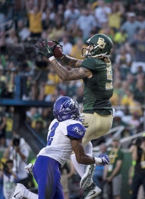 Sep 1, 2018; Waco, TX, USA; Baylor Bears wide receiver Jalen Hurd (5) catches a pass for a touchdown as Abilene Christian Wildcats safety Brandon Richmond (2) defends during the first quarter at McLane Stadium. Mandatory Credit: Jerome Miron-USA TODAY Sports