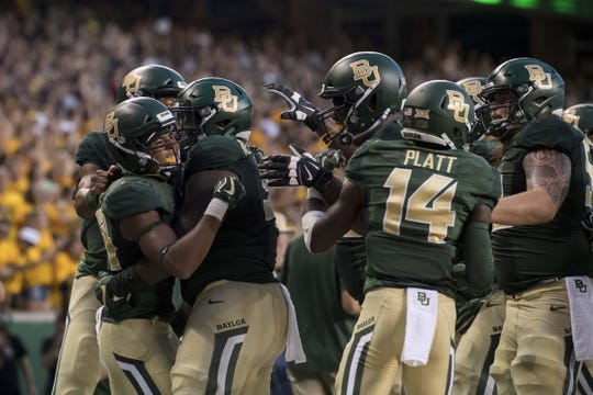 Sep 1, 2018; Waco, TX, USA; Baylor Bears wide receiver Marques Jones (left) celebrates after catching a pass for a touchdown against the Abilene Christian Wildcats during the first quarter at McLane Stadium. Mandatory Credit: Jerome Miron-USA TODAY Sports