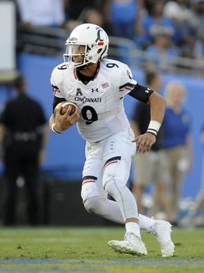 September 1, 2018; Pasadena, CA, USA; Cincinnati Bearcats quarterback Desmond Ridder (9) runs the ball against the UCLA Bruins during the second half at the Rose Bowl. Mandatory Credit: Gary A. Vasquez-USA TODAY Sports