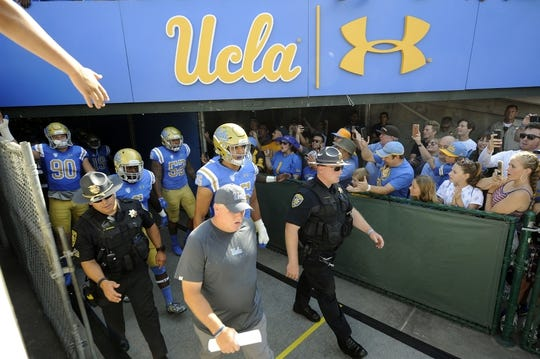 September 1, 2018; Pasadena, CA, USA; UCLA Bruins head coach Chip Kelly leads the Bruins out before playing against the Cincinnati Bearcats at the Rose Bowl. Mandatory Credit: Gary A. Vasquez-USA TODAY Sports