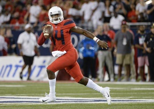 Sep 1, 2018; Tucson, AZ, USA; Arizona Wildcats quarterback Khalil Tate (14) runs the ball against the Brigham Young Cougars during the first quarter at Arizona Stadium. Mandatory Credit: Casey Sapio-USA TODAY Sports