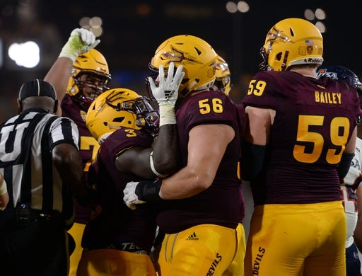 Sep 1, 2018; Tempe, AZ, USA; Arizona State Sun Devils running back Eno Benjamin (3) celebrates with offensive lineman Alex Losoya (56) after scoring a touchdown against the UTSA Roadrunners during the first half at Sun Devil Stadium. Mandatory Credit: Joe Camporeale-USA TODAY Sports