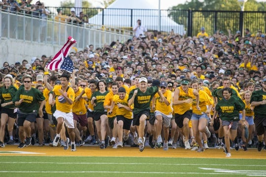 Sep 1, 2018; Waco, TX, USA; Baylor Bears students run on to the field before the game against the Abilene Christian Wildcats at McLane Stadium. Mandatory Credit: Jerome Miron-USA TODAY Sports