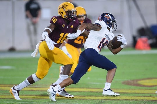 Sep 1, 2018; Tempe, AZ, USA; UTSA Roadrunners wide receiver Kirk Johnson Jr. (16) runs after making a catch against Arizona State Sun Devils safety Aashari Crosswell (16) during the second half at Sun Devil Stadium. Mandatory Credit: Joe Camporeale-USA TODAY Sports