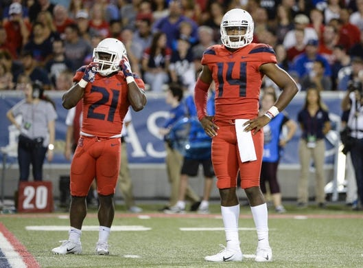 Sep 1, 2018; Tucson, AZ, USA; Arizona Wildcats quarterback Khalil Tate (14) and running back J.J. Taylor (21) (left) look to the sideline during the second half against the Brigham Young Cougars at Arizona Stadium. Mandatory Credit: Casey Sapio-USA TODAY Sports