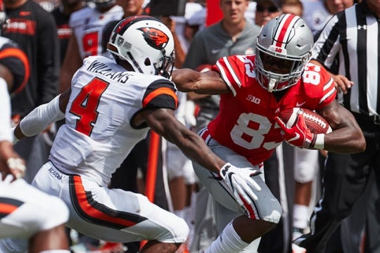 Sep 1, 2018; Columbus, OH, USA; Ohio State Buckeyes wide receiver Terry McLaurin (83) runs the ball at Oregon State Beavers cornerback Dwayne Williams (4) against the Oregon State Beavers in the first half at Ohio Stadium. Mandatory Credit: Rick Osentoski-USA TODAY Sports