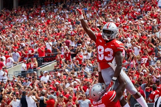 Sep 1, 2018; Columbus, OH, USA; Ohio State Buckeyes wide receiver Terry McLaurin (83) is lifted in the air by offensive lineman Thayer Munford (75) after scoring a touchdown against the Oregon State Beavers in the first half at Ohio Stadium. Mandatory Credit: Rick Osentoski-USA TODAY Sports
