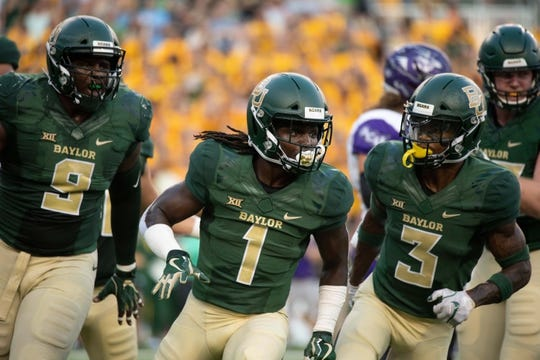Sep 1, 2018; Waco, TX, USA; Baylor Bears safety Verkedric Vaughns (1) and defensive tackle Ira Lewis (9) and safety Chris Miller (3) in action during the game against the Abilene Christian Wildcats at McLane Stadium. Mandatory Credit: Jerome Miron-USA TODAY Sports