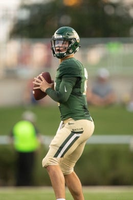 Sep 1, 2018; Waco, TX, USA; Baylor Bears quarterback Charlie Brewer (12) in action during the game against the Abilene Christian Wildcats at McLane Stadium. Mandatory Credit: Jerome Miron-USA TODAY Sports
