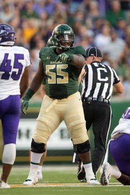 Sep 1, 2018; Waco, TX, USA; Baylor Bears offensive lineman Xavier Newman (55) in action during the game against the Abilene Christian Wildcats at McLane Stadium. Mandatory Credit: Jerome Miron-USA TODAY Sports