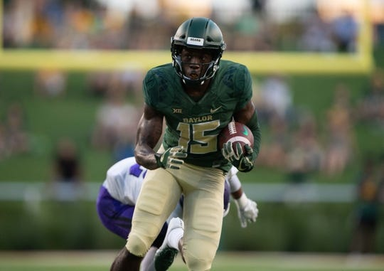 Sep 1, 2018; Waco, TX, USA; Baylor Bears wide receiver Denzel Mims (15) in action during the game against the Abilene Christian Wildcats at McLane Stadium. Mandatory Credit: Jerome Miron-USA TODAY Sports