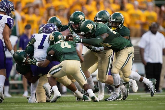 Sep 1, 2018; Waco, TX, USA; Abilene Christian Wildcats wide receiver D.J. Fuller (1) is tackled by the Baylor Bears defense during the game at McLane Stadium. Mandatory Credit: Jerome Miron-USA TODAY Sports