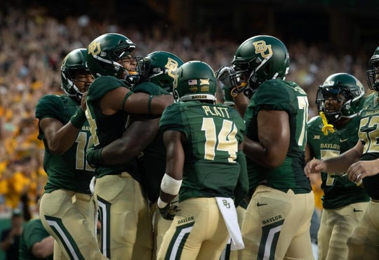 Sep 1, 2018; Waco, TX, USA; Baylor Bears wide receiver Marques Jones (84) and his team celebrate a touchdown during the game against the Abilene Christian Wildcats at McLane Stadium. Mandatory Credit: Jerome Miron-USA TODAY Sports