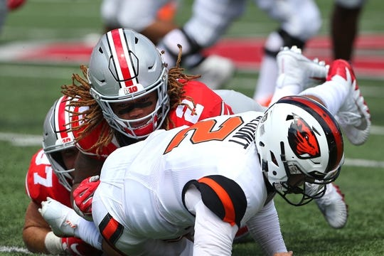 Sep 1, 2018; Columbus, OH, USA; Ohio State Buckeyes defensive end Chase Young (2) tackles Oregon State Beavers quarterback Conor Blount (2) at Ohio Stadium. Mandatory Credit: Joe Maiorana-USA TODAY Sports