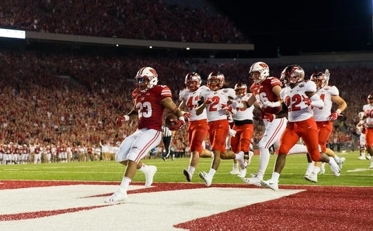 Aug 31, 2018; Madison, WI, USA; Wisconsin Badgers running back Jonathan Taylor (23) scores a touchdown during the game against the Western Kentucky Hilltoppers at Camp Randall Stadium. Mandatory Credit: Jeff Hanisch-USA TODAY Sports