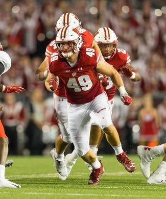 Aug 31, 2018; Madison, WI, USA; Wisconsin Badgers tight end Kyle Penniston (49) during the game against the Western Kentucky Hilltoppers at Camp Randall Stadium. Mandatory Credit: Jeff Hanisch-USA TODAY Sports