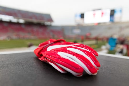 Aug 31, 2018; Madison, WI, USA; Western Kentucky Hilltoppers gloves sit on the sidelines during warmups prior to the game against the Wisconsin Badgers at Camp Randall Stadium. Mandatory Credit: Jeff Hanisch-USA TODAY Sports